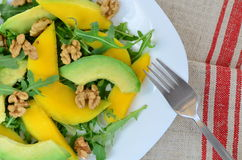Fruit salad with mango, avocado, rucola and walnuts Stock Images