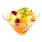 Fruit salad in a martini glass isolated on white Royalty Free Stock Photo