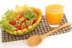 Fruit salad in the melon fruit with orange fusion food Stock Photos