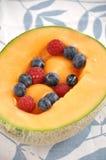 Fruit salad in melon Stock Photo