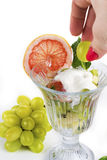 Fruit salad with mint and sour cream Stock Images