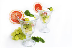 Fruit salad with mint and sour cream Stock Photos