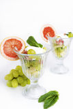 Fruit salad with mint and sour cream Royalty Free Stock Photos