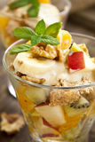 Fruit salad with nuts and mint Stock Photo