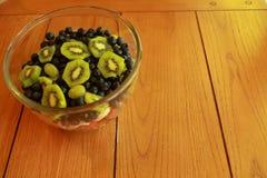 Fruit salad on an oak table Royalty Free Stock Photos