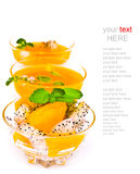 Fruit salad and orange juice on white (with sample text) Royalty Free Stock Photos