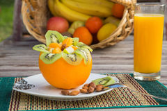 Fruit salad in the orange skin Royalty Free Stock Photography