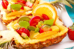 Fruit salad in pineapple Stock Photos