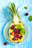 Fruit salad in pineapple Stock Photos