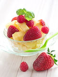 Fruit salad. From pineapples, strawberries and raspberries Stock Images