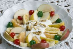 Fruit salad in a plate. Fruit salad plate with yogurt and nuts.Good presentation for recipes book. Focusing only on the middle-ground to diversity from classic royalty free illustration