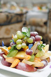 Fruit salad on a plate. Fruit salad (grape, apple, pear, orange, mix) on a plate in fine restaurant Stock Photos