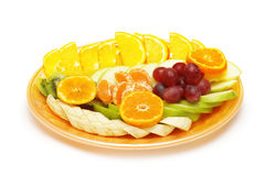 Fruit salad in the plate isolated Stock Photo