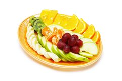 Fruit salad in the plate isolated on the white Stock Photos