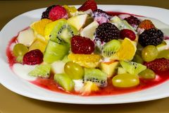 Fruit salad on a plate royalty free stock image