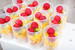 Fruit salad in push up cake forms Royalty Free Stock Image