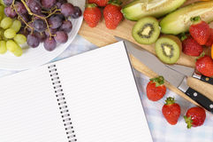 Fruit salad, recipe book, copy space Stock Photography
