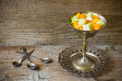 Fruit salad. On rustic wooden background Stock Photography