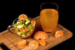 Fruit salad, segments of tangerine and glass with drink Royalty Free Stock Image