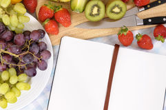 Fruit salad selection, recipe book, copy space Royalty Free Stock Image