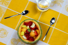 Fruit salad served in a melon Stock Photography