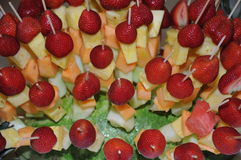Fruit salad with skewered strawberries, pineapple and melon pieces Royalty Free Stock Images