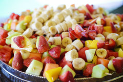 Fruit salad on skewers Stock Images
