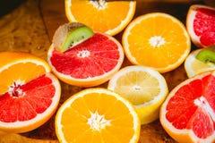 Fruit salad, sliced kiwi, orange, lemon, grapefruit Royalty Free Stock Photos
