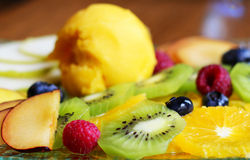 Fruit salad with sorbet. On the glass plate Royalty Free Stock Image