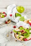 Fruit salad with spinach and granola stock image