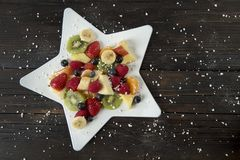Fruit salad in the star royalty free stock photo