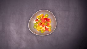 Fruit salad stop motion stock footage