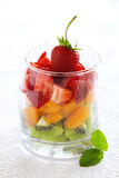 Fruit salad of strawberries,. Kiwis and apricots royalty free stock image