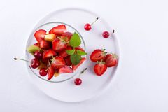Fruit salad of strawberries, kiwis and apricots. Fresh and tasty snack royalty free stock images