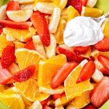 Fruit salad with strawberries, oranges, bananas and sour cream Royalty Free Stock Photos