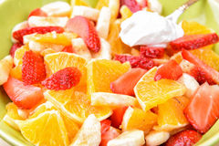 Fruit salad with strawberries, oranges, bananas and sour cream Stock Photos