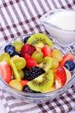 Fruit salad with strawberries, oranges, kiwi Stock Photos