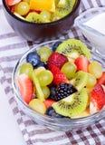 Fruit salad with strawberries, oranges, kiwi, blueberries Royalty Free Stock Image