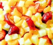 Fruit salad with strawberries, oranges and peaches for background Stock Images