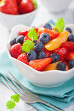 Fruit salad with strawberry blueberry apricot Stock Images