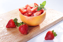Fruit salad with strawberry and grapefruit. Fruit salad in hollowed-out grapefruit stuffed with strawberry stock images