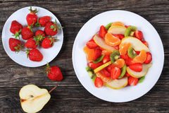 Fruit salad of strawberry, kiwi fruit and pear Royalty Free Stock Photos