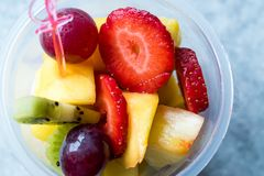 Fruit Salad with Strawberry, Kiwi, Mango and Grape in Plastic Cup. Royalty Free Stock Images