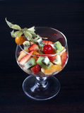 Fruit salad in tall wine glass Royalty Free Stock Image