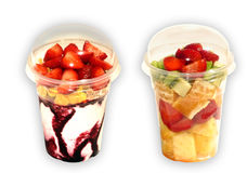 Fruit salad to go. Fruit salad and ice cream in a plastic cups with lids on. Served for take-out Royalty Free Stock Photography