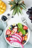 Fruit salad with tropical fruits in a bowl Royalty Free Stock Photos