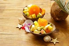Fruit salad of tropical fruits. Mango, banana, kiwi Royalty Free Stock Images