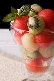 Fruit salad of watermelon, melons and kiwi in a glass close up v Royalty Free Stock Image