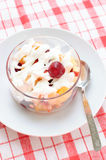 Fruit salad with whipped cream Stock Photo