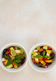 Fruit salad in white dishes Royalty Free Stock Image